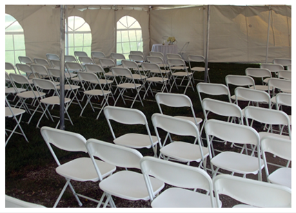 White chairs in a tent for a wedding